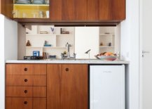 Wooden-cabinets-bring-warmth-to-the-small-studio-apartment-in-white-84514-217x155