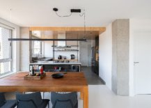 Wooden-ceiling-and-a-change-in-floor-delineates-the-kitchen-from-the-living-area-and-dining-space-84419-217x155
