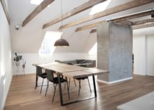 Wooden-ceiling-beams-and-concrete-wall-section-in-the-dining-area-of-the-apartment-43608-217x155