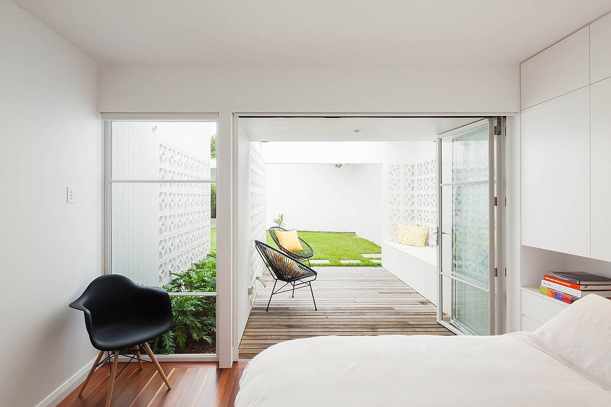 Wooden deck extends from the bedroom and into the garden outside