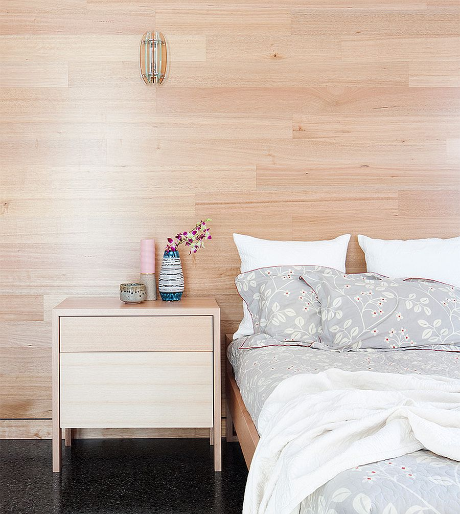 Wooden walls in the bedroom gives it a cozy and comfortable visual appeal