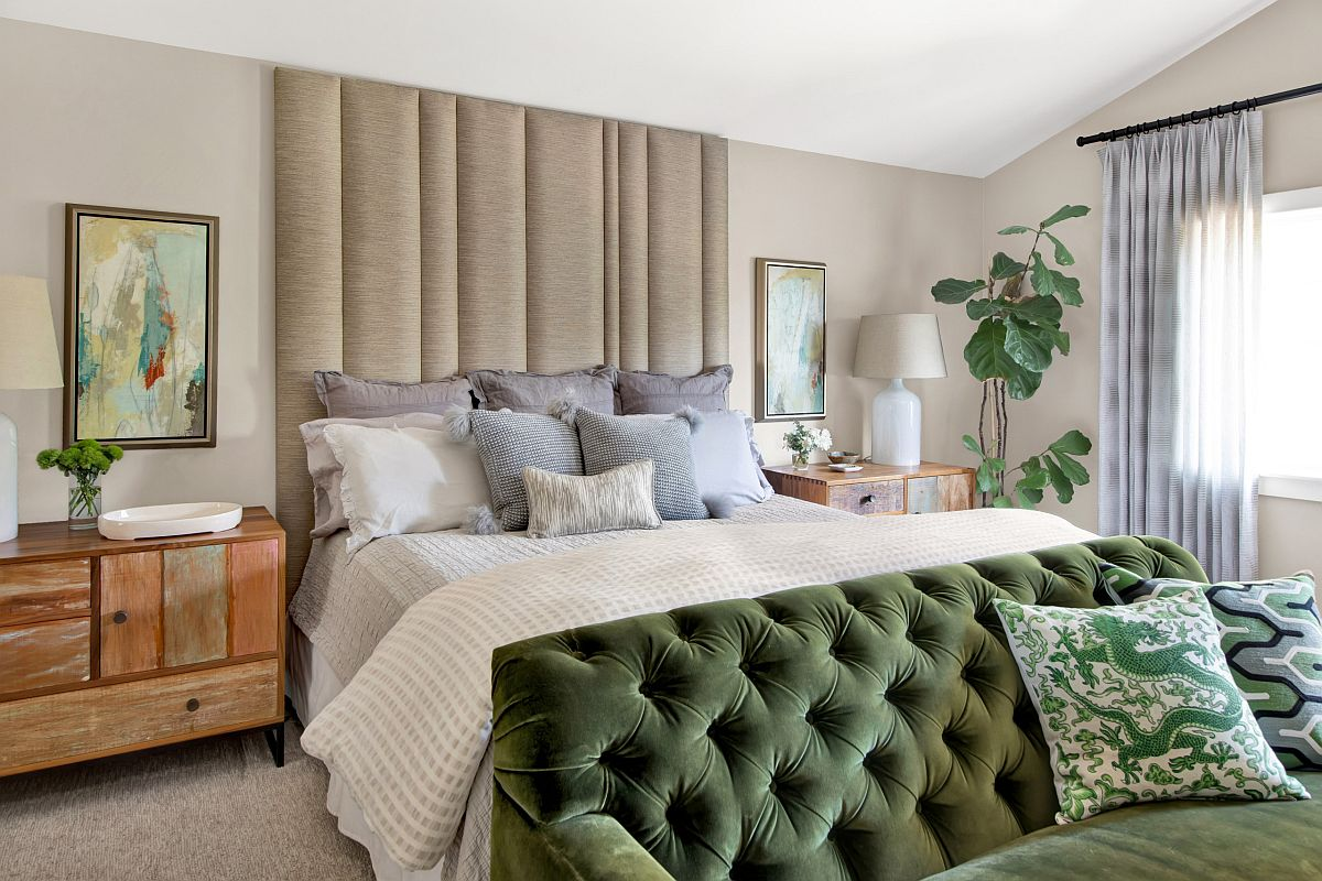 A splash of green, white backdrop and natural light give this bedroom a relaxing appeal