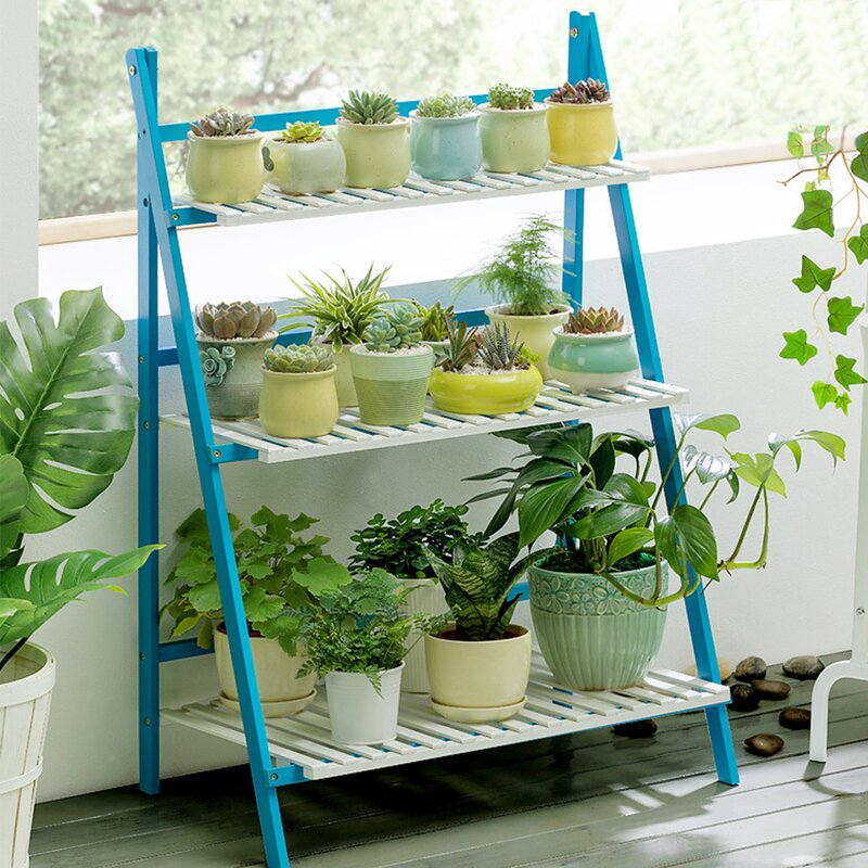 Bamboo ladder plant stand in blue and white