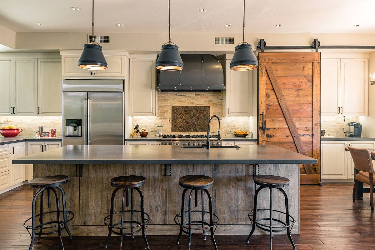 Bar stools and pendants bring edgy vibe to this kitchen