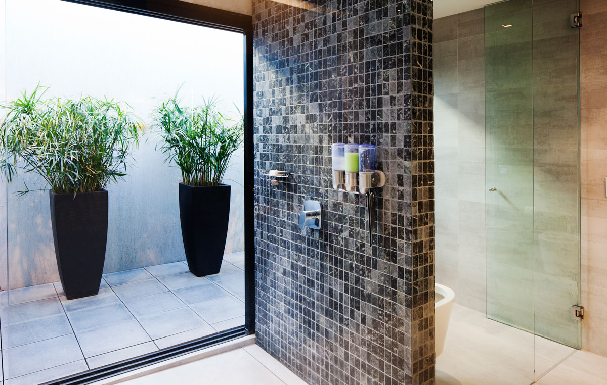 Bathroom-on-the-upper-level-of-the-house-with-a-stone-shower-area-66883