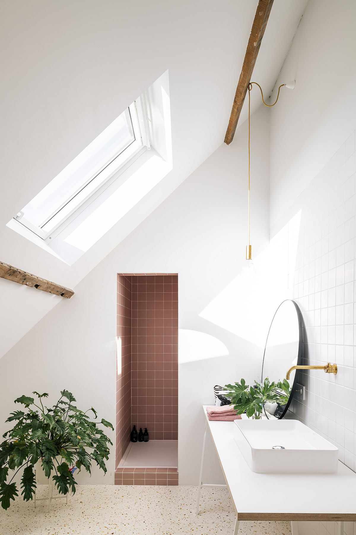 Beautiful window brings natural light into the bathroom with white walls and tiled shower area