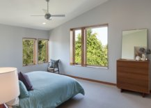 Bedroom-with-sloped-ceiling-neutral-color-scheme-and-bedding-in-blue-88225-217x155