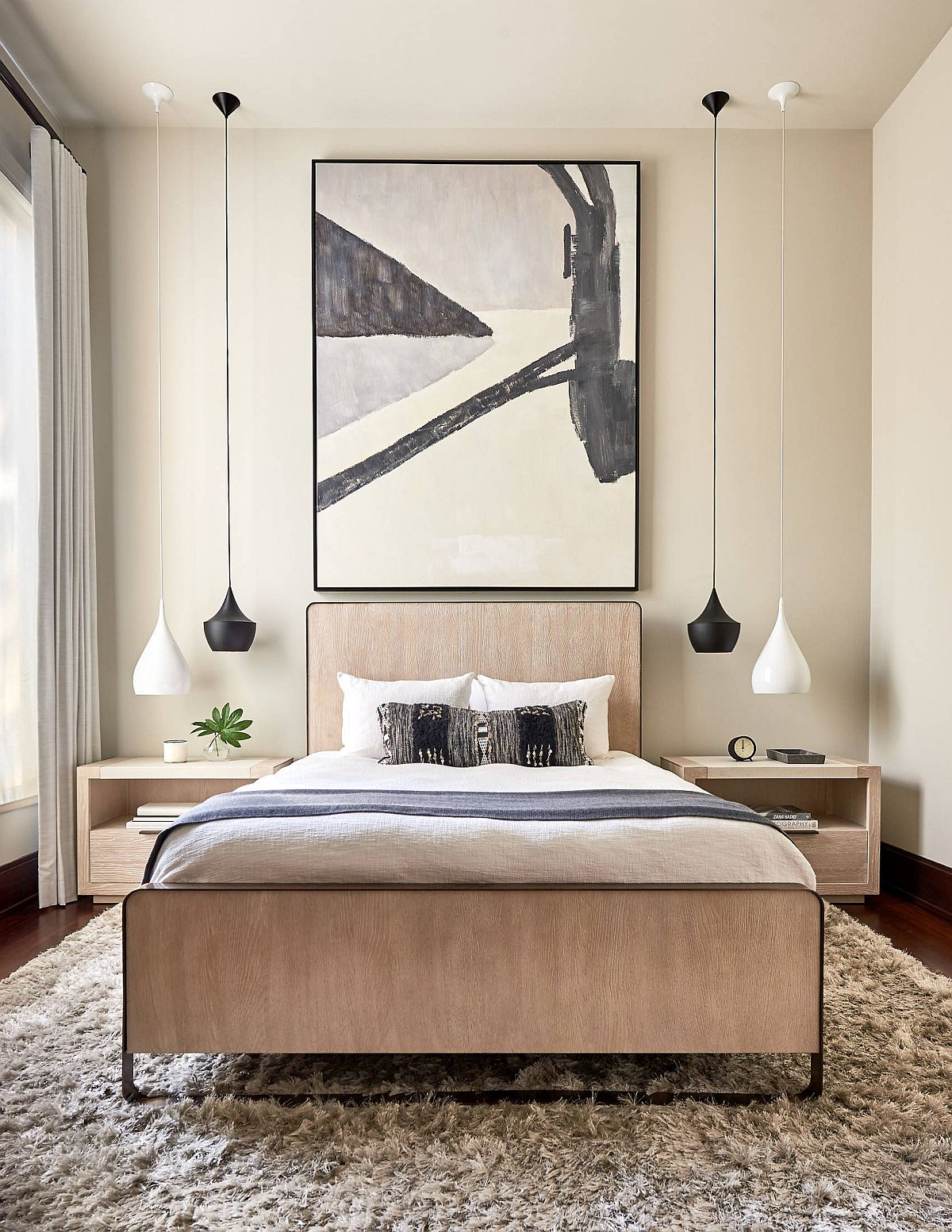 Black and white Tom Dixon pendant lights are used elegantly in this contemporary bedroom