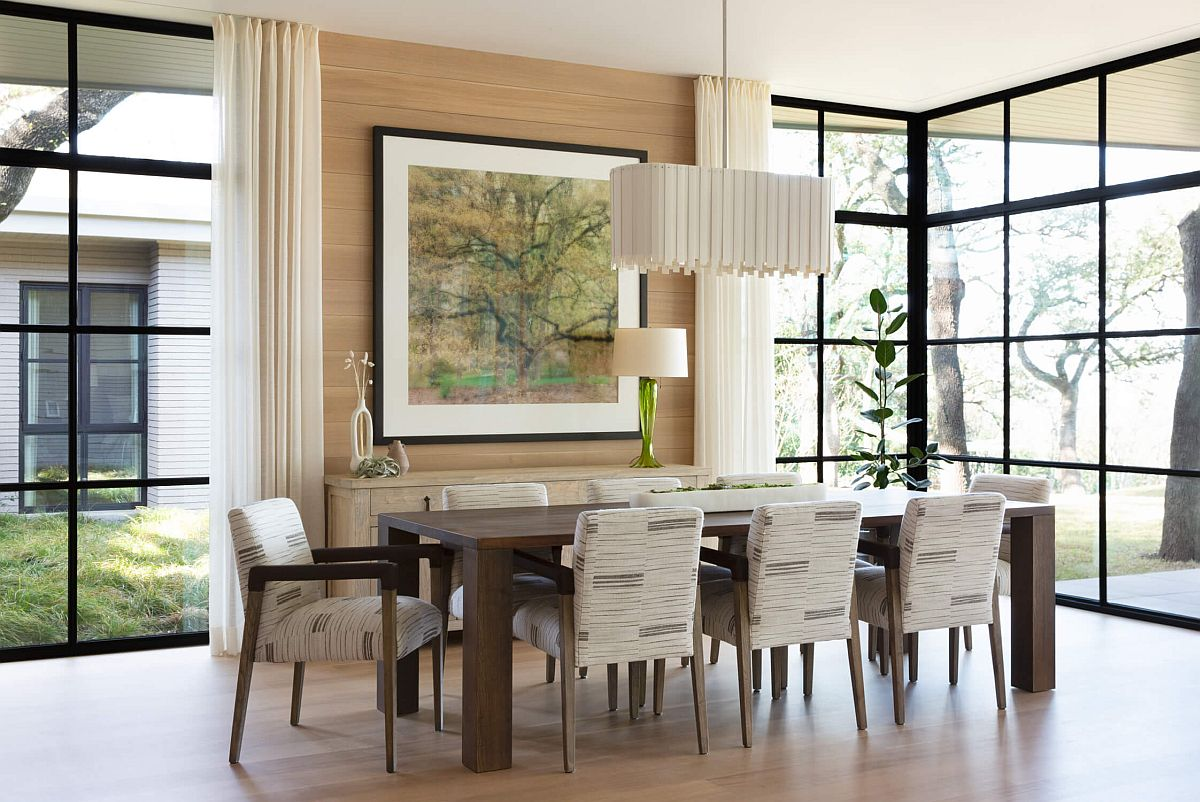 Black-framed-glass-windows-connect-the-large-dining-room-with-the-landscape-outside-27002