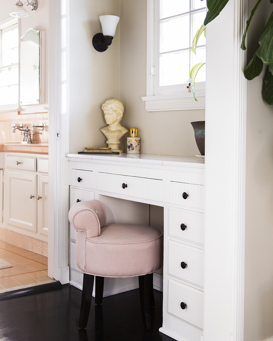 Built-in vanity area with a cusioned stool