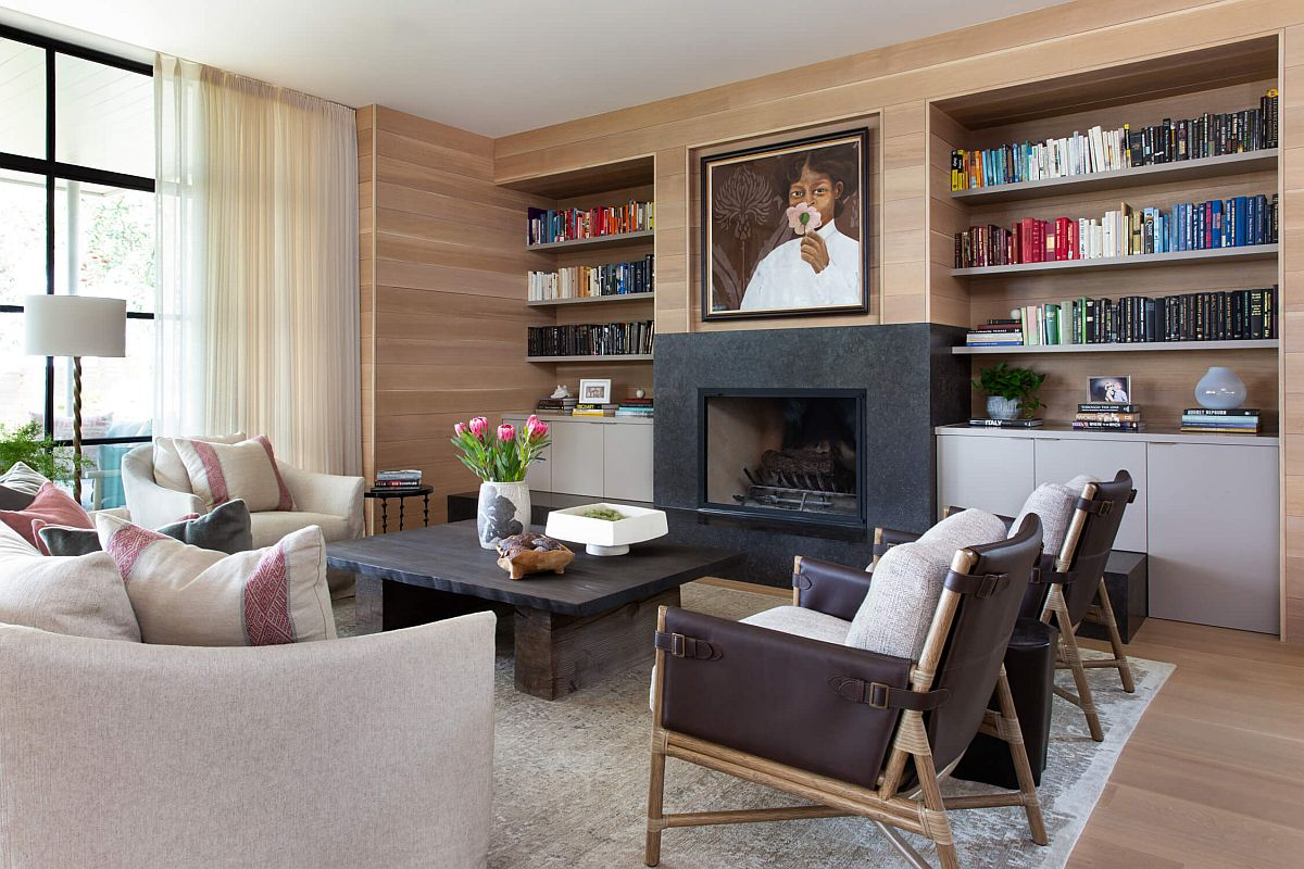 Charming woodsy walls, lovely sue of beige and a lage bookshelf create this wonderful living area