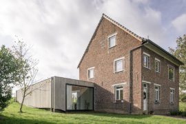 Beautiful Brick House in The Fields Gets a Half-Sunk Modern Extension