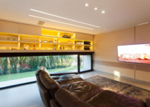 Custom-TV-room-on-the-lower-level-with-tech-savvy-design-and-right-acoustics-58642-217x155