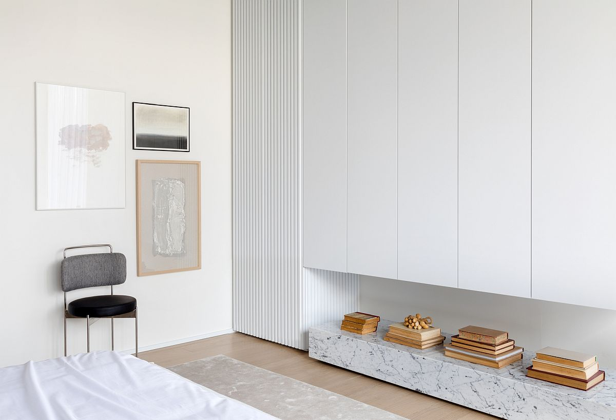 Custom-storage-areas-and-niche-sprovide-ample-space-for-everything-you-need-inside-this-dream-bedroom-scape-80643