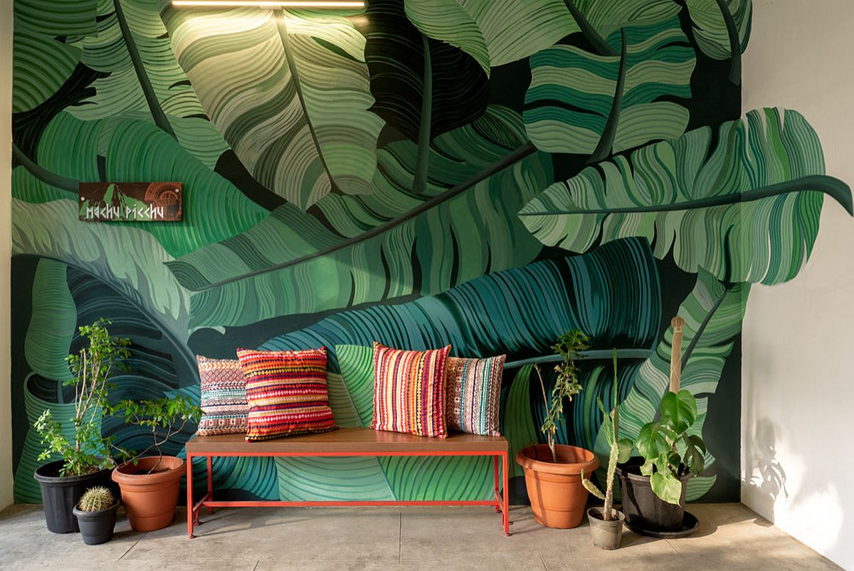 Custom wall decal with giant banana leaves welcomes you at this lovely little entry in Chennai, India