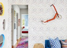 Custom-wallpaper-and-little-scooter-on-the-wall-bring-eclectic-charm-to-this-lovely-little-room-77143-217x155