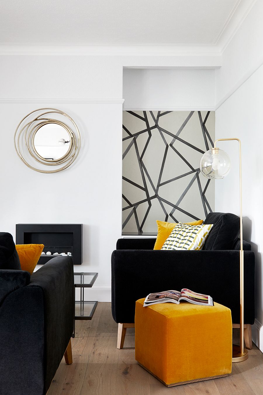 Dark sofa and club chairs coupled with yellow accents and side table in the living room