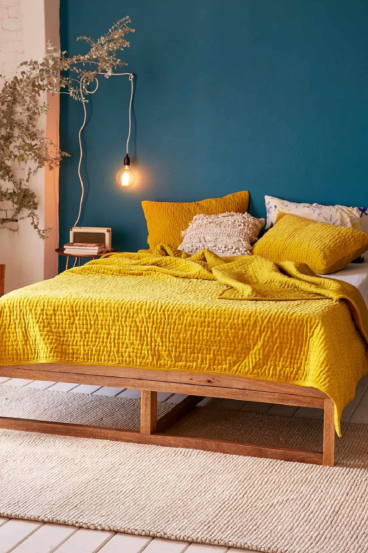 Darker-yellows-coupled-with-blue-in-the-bedroom-look-absolutely-gorgeous-12208