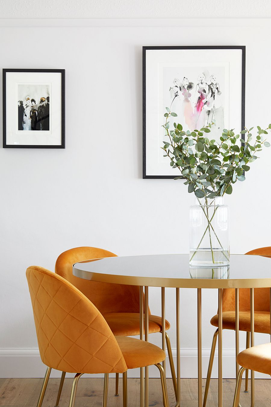 Decorating the modern dining room with lovely framed art work