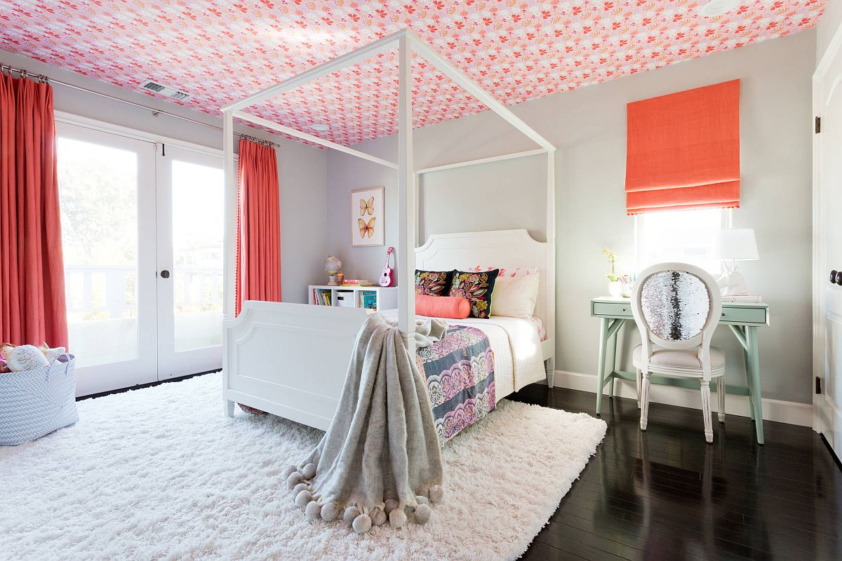 Delightful girls' bedroom with wallpaper on the ceiling that accentuates the color scheme of the room