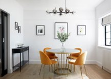 Delightful modern dining room with round white and gold dining table and four yellow chairs 71314 217x155 - Black, White and Brilliant Pops of Yellow Revitalize Old Epsom Apartment