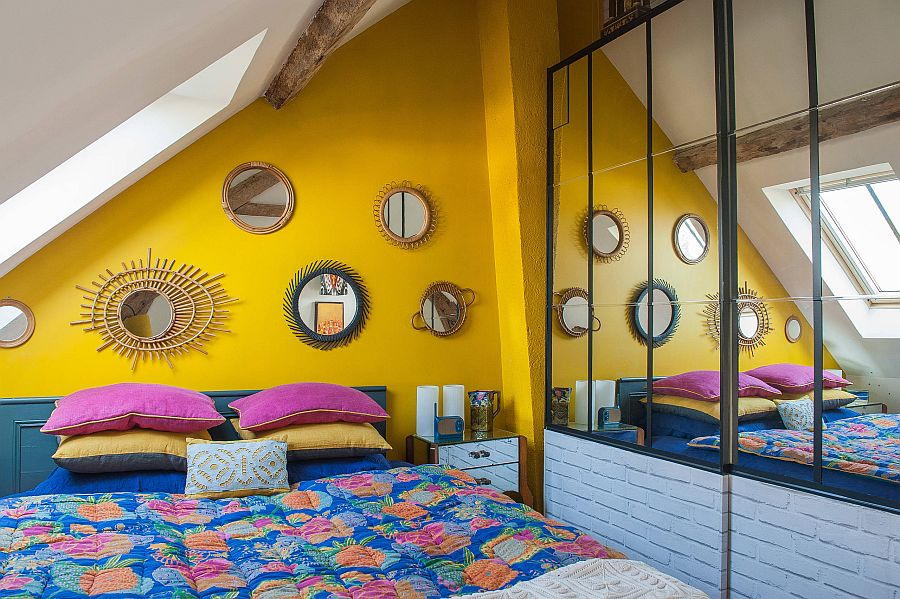 Delightful-small-Mediterranean-bedroom-in-the-attic-with-an-accent-yellow-wall-and-blue-bedding-13602