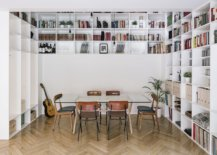 Double-height-central-living-area-of-the-house-with-bookshelves-and-glass-table-12691-217x155