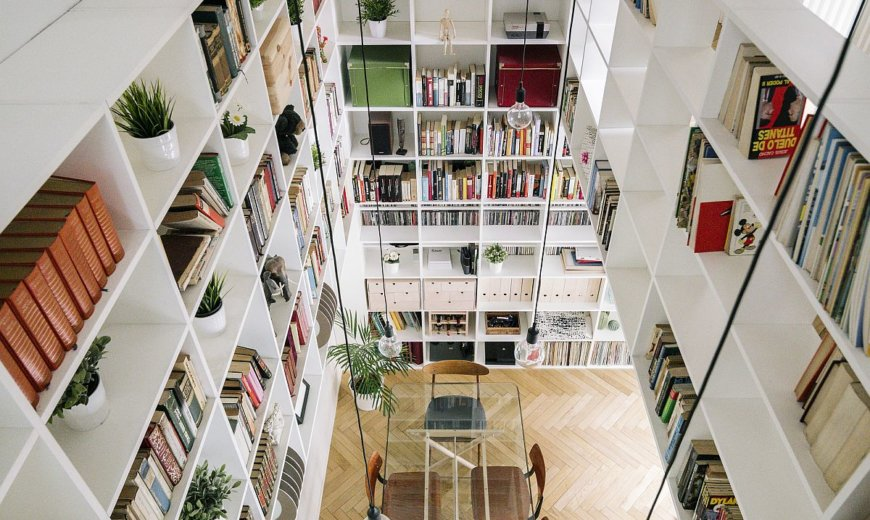 Double-Height Living Area with Awesome Bookshelves Reinvigorates this Madrid Home