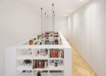 Dramatic-bookshelves-become-a-part-of-both-the-lower-and-upper-levels-of-the-house-44119-217x155