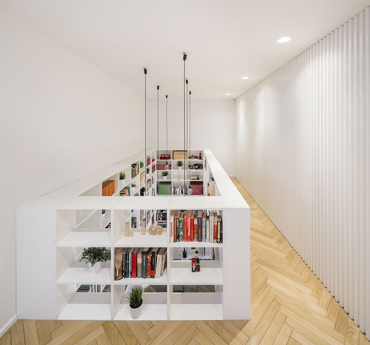 Dramatic bookshelves become a part of both the lower and upper levels of the house