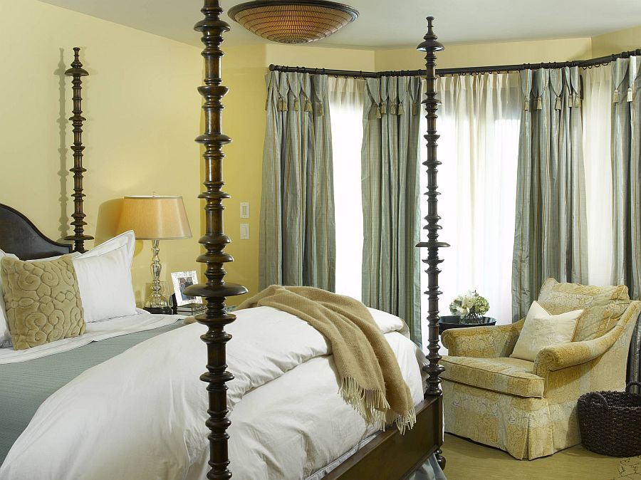 Drapes-and-bedding-are-used-to-add-gray-to-this-bedroom-in-yellow-90251