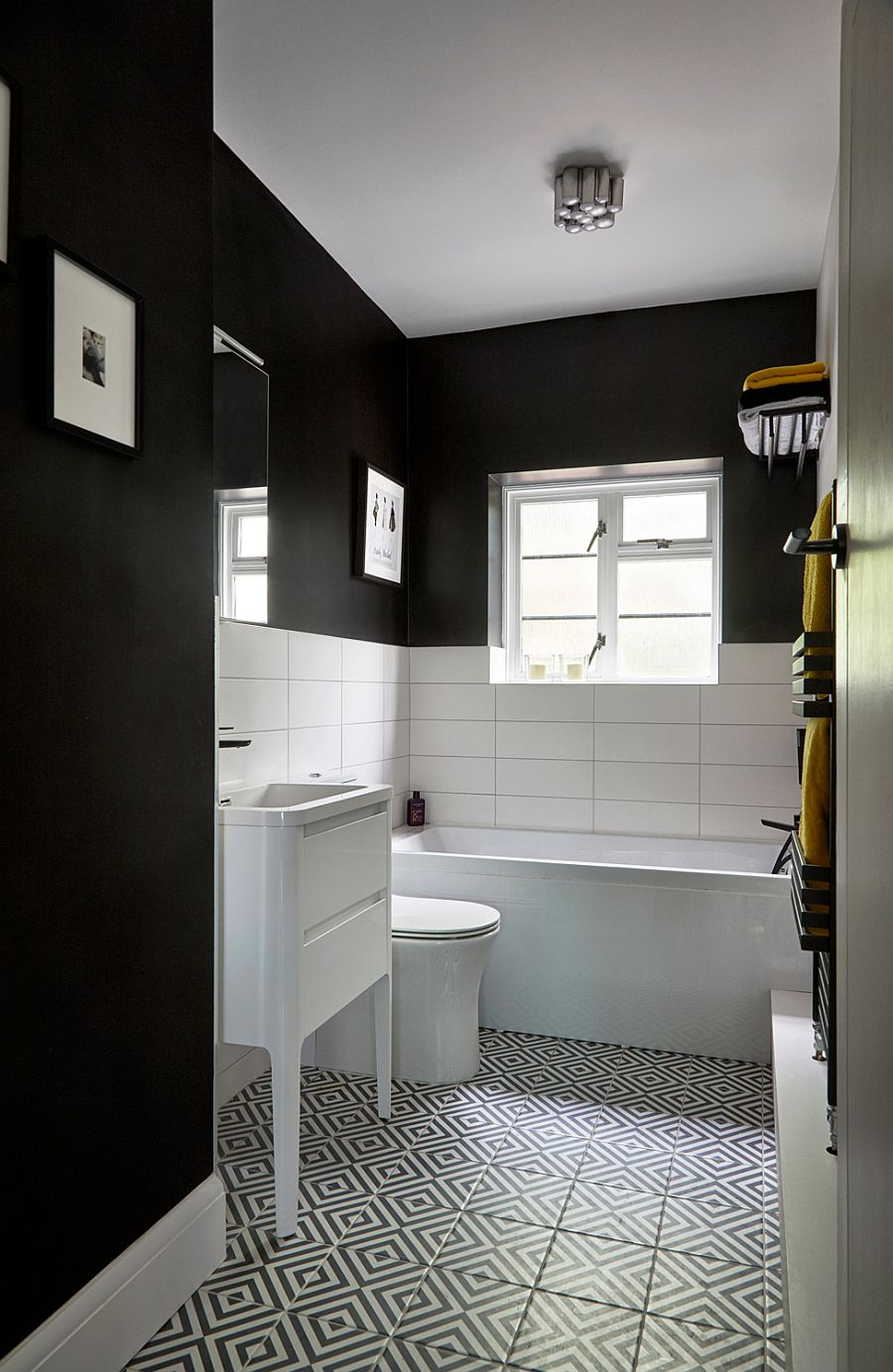 Eclectic contemporary bathroom in black and white with floor tiles that usher in pattern