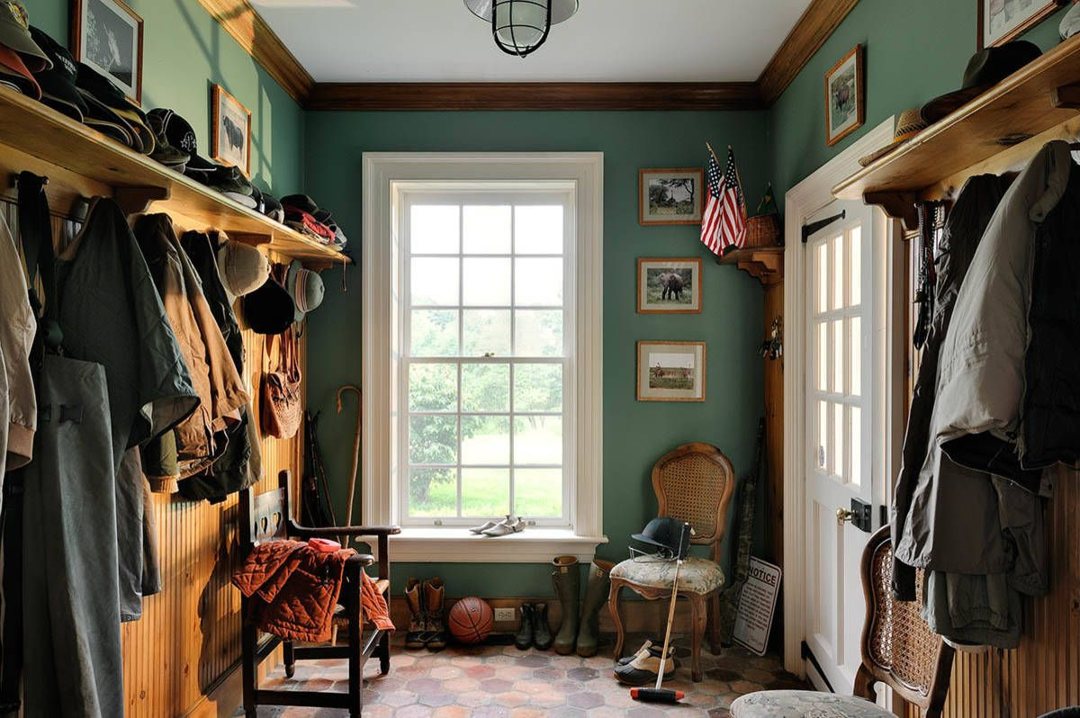 Entryway in this house looks busy thanks to it eclectic style