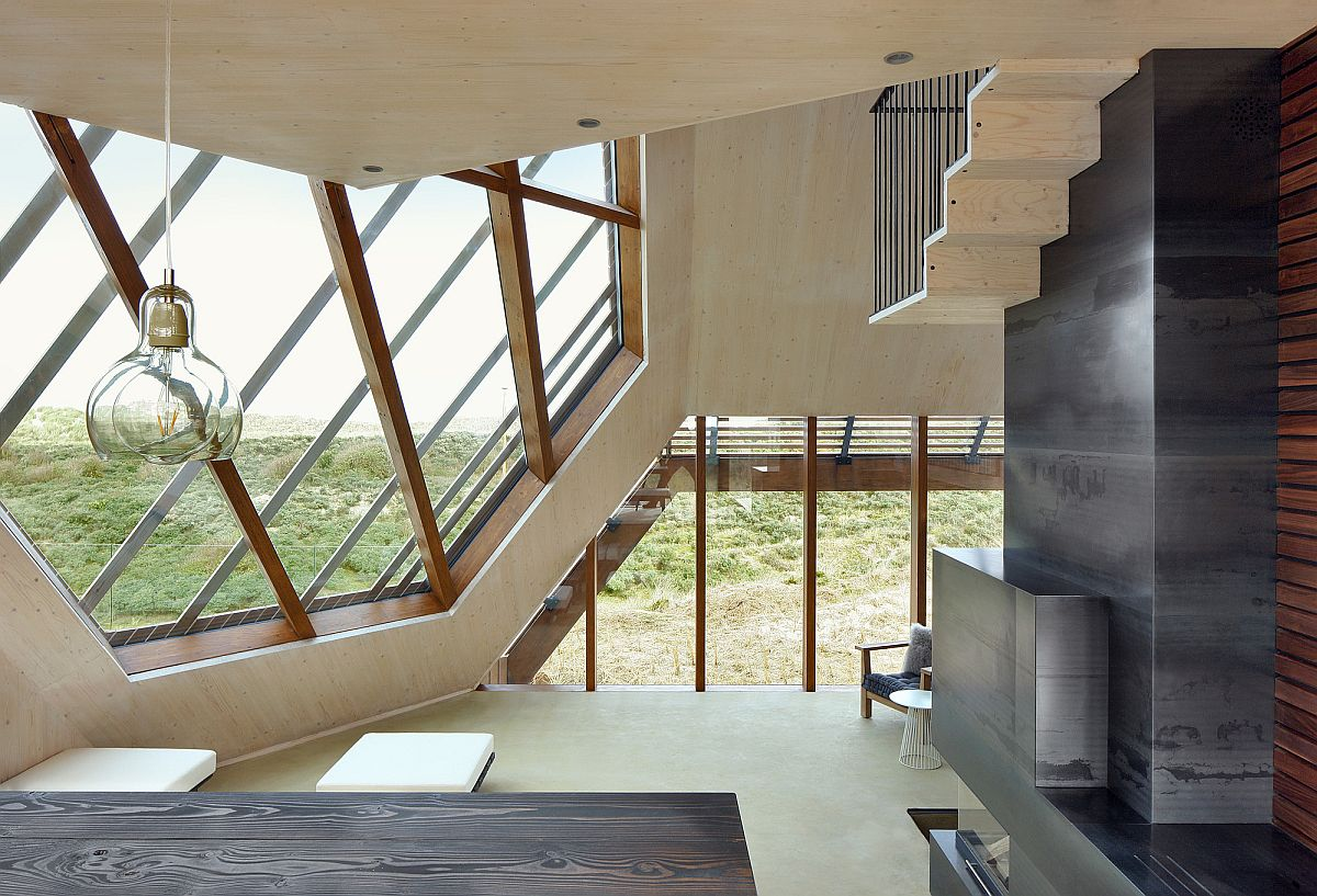 Exceptional diamond structure of the house coupled with multiple windows creates a stunning interior