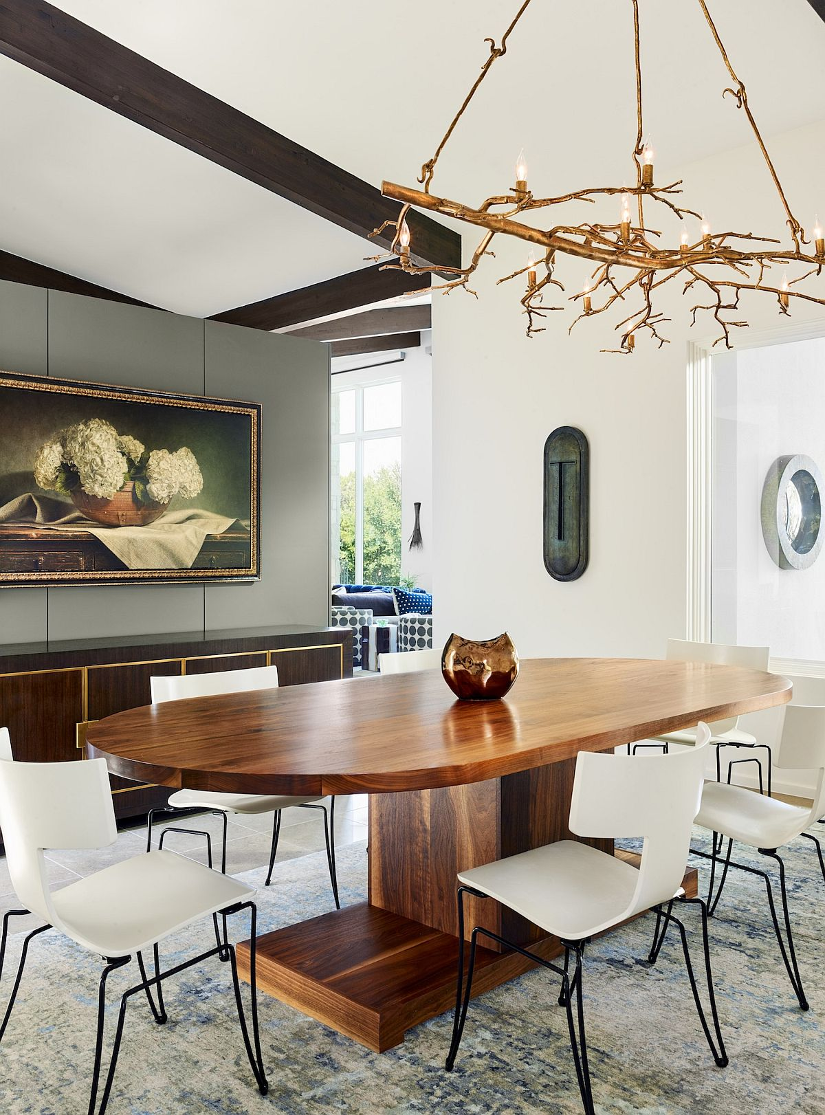 Fabulous custom lighting fixture in the dining room with a large, oval wooden table