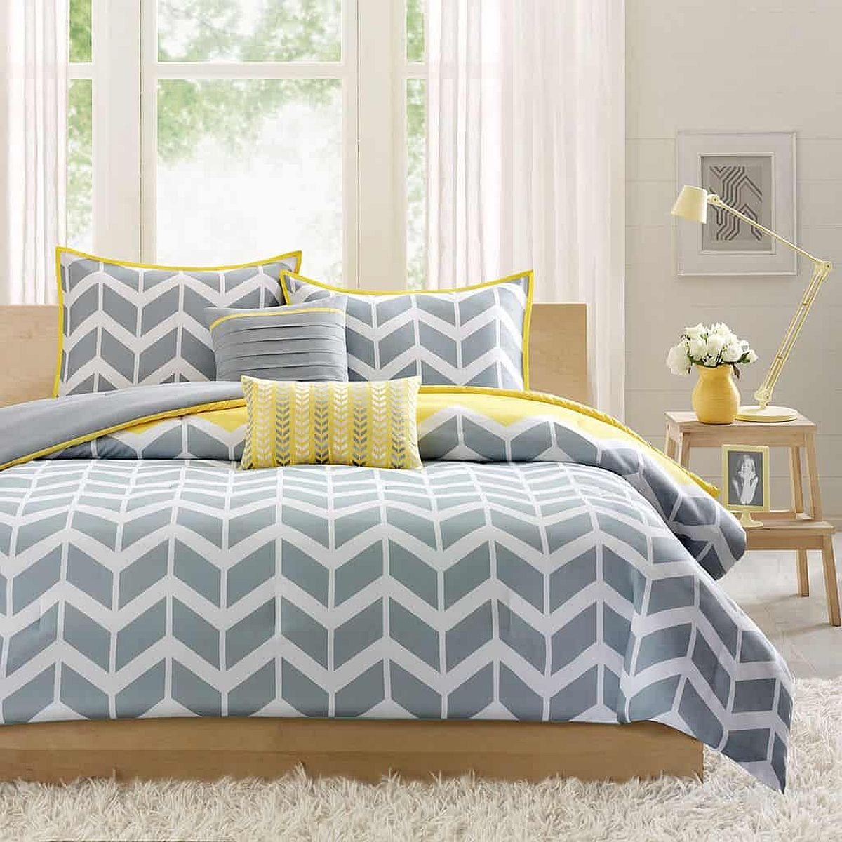 Fabulous-gray-and-yellow-bediing-with-chevron-design-brings-both-color-and-pattern-to-this-bedroom-in-white-48392