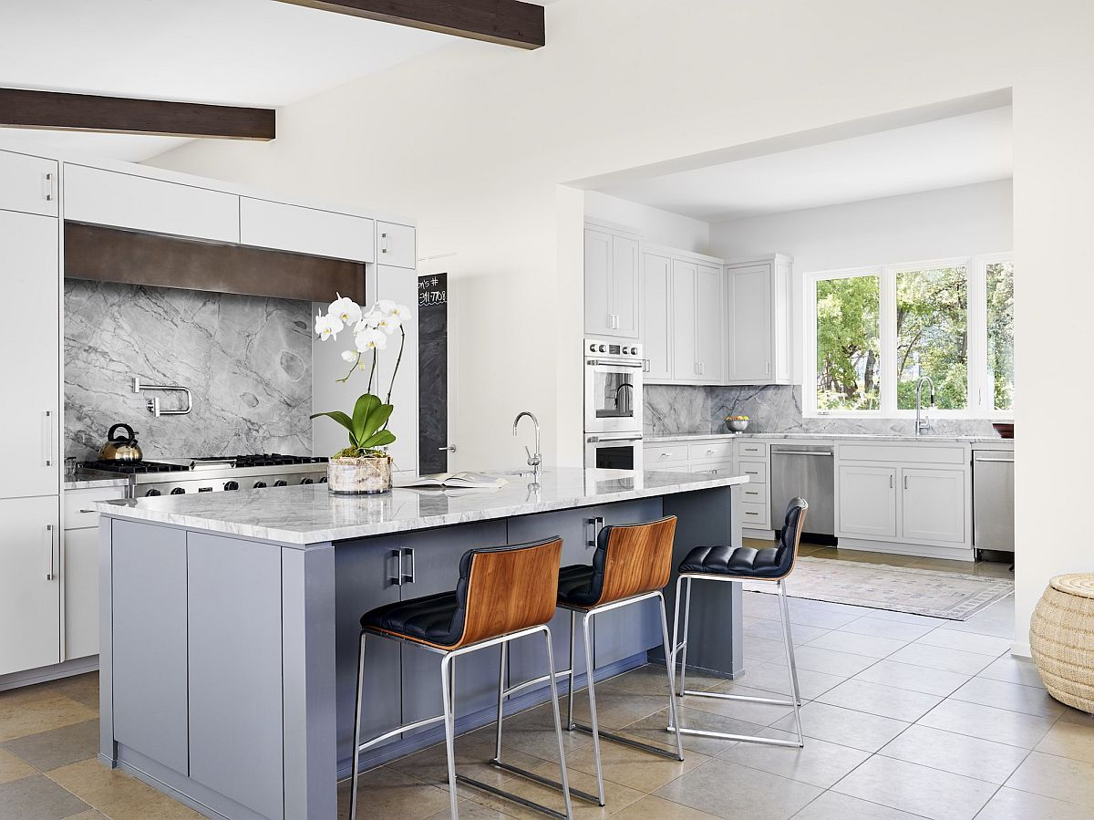 Fabulous kitchen in white with a light blue island and space-savvy design