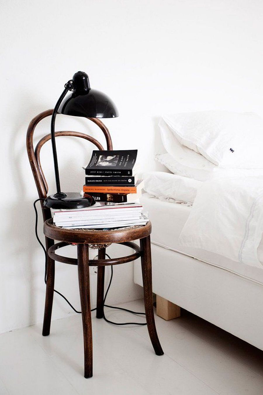 Finding new purpose for that old chair as a nightstand