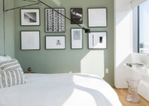 Gallery-wall-with-black-and-white-photographs-set-against-a-pastel-green-wall-steals-the-show-in-this-bedroom-of-New-York-home-62212-217x155