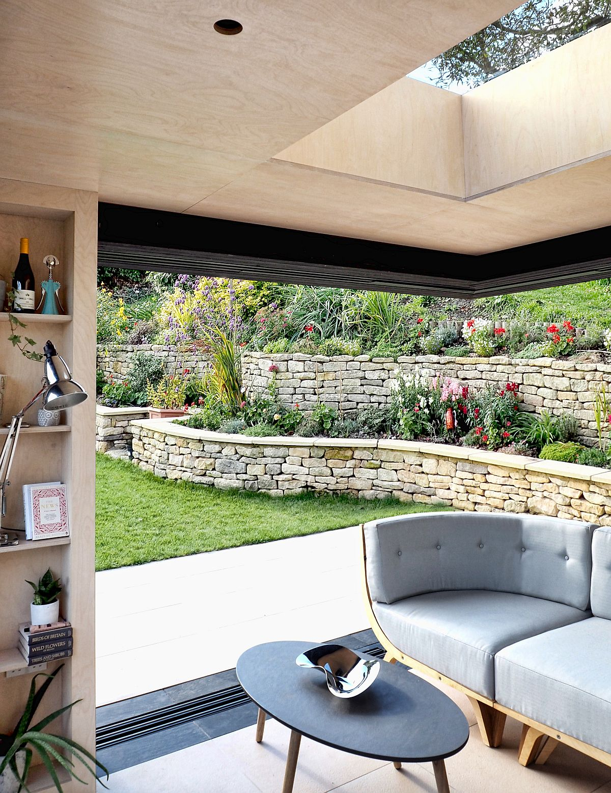 Garden adds to the style of the reading room while extending the interior outdoors