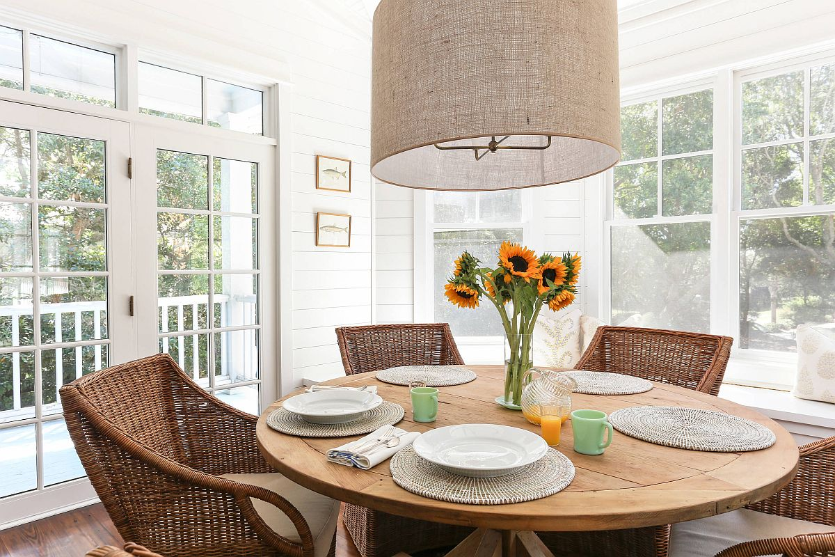 Give the dining room a holiday vibe with chic, beach style decor and a neutral backdrop in white