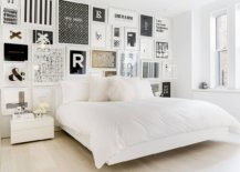 Gorgeous-black-and-white-gallery-wall-in-this-bedroom-leaves-its-white-monochromatic-backdrop-largely-unaltered-69994-217x155