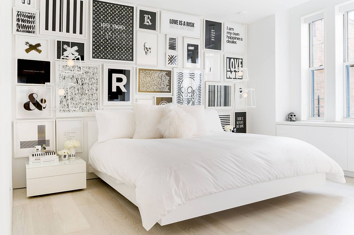 Gorgeous-black-and-white-gallery-wall-in-this-bedroom-leaves-its-white-monochromatic-backdrop-largely-unaltered-69994