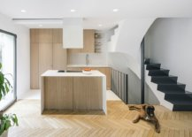 Gorgeous-new-kitchen-of-the-Madrid-house-in-white-and-wood-with-chevron-pattern-floor-13456-217x155