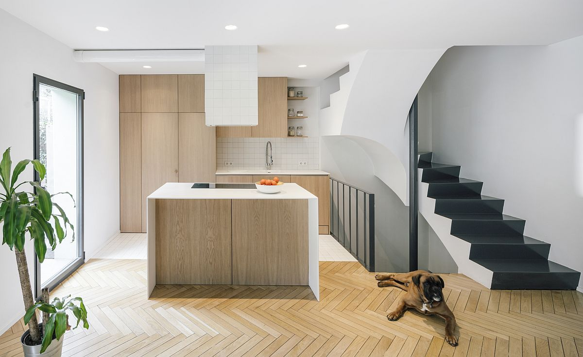 Gorgeous new kitchen of the Madrid house in white and wood with chevron pattern floor