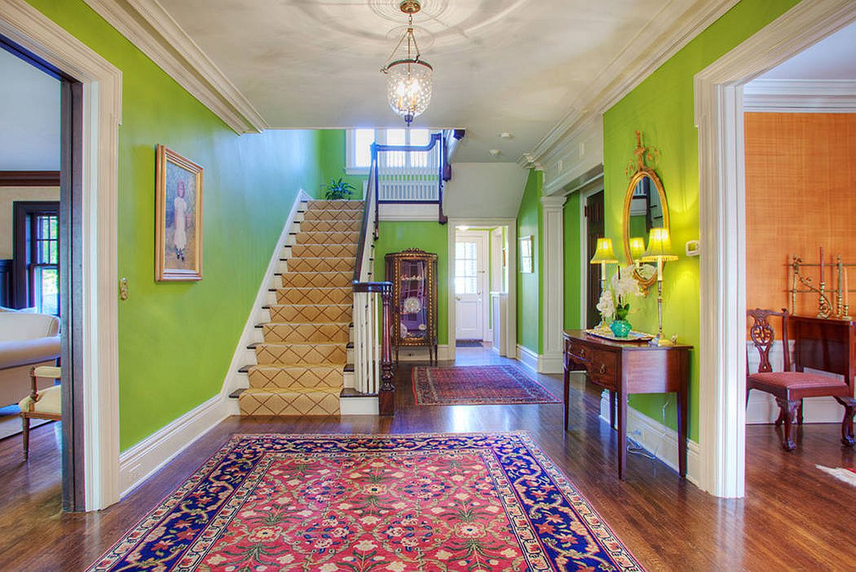 Grand traditional entrance with beautiful chandelie and green walls