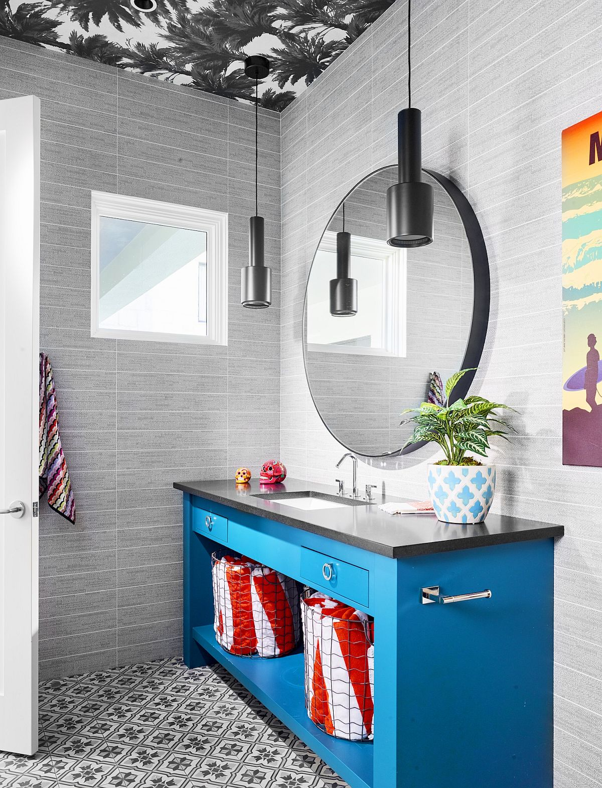 Gray powder room with wallpaper clad ceiling and a bright blue vanity that steals the show