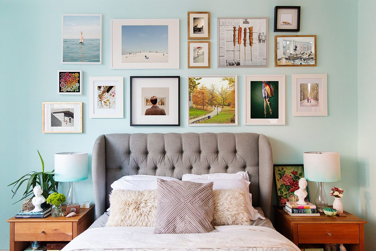 Headboard gallery wall steals the spotlight in this modest modern bedroom in blue