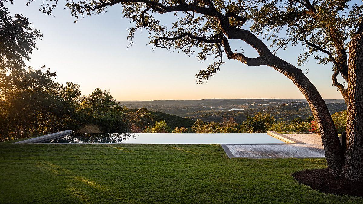 Infinity edge pool and view of Austin's iconic Pennybacker Bridge at the Ridge Oak Residence