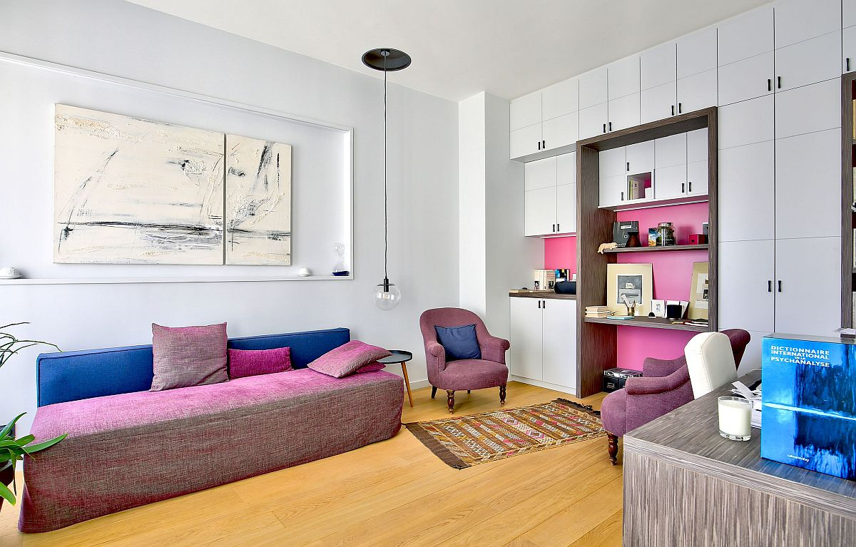 Inside-of-the-shelves-and-the-sofa-adds-pink-to-this-modern-home-office-86088